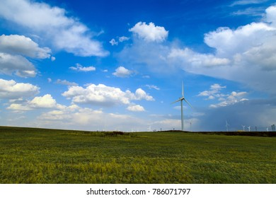 Windmill used to generate electricity in the prairie