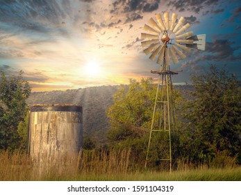 Windmill used outback at the farms to pump water for the livestock, dramatic sunset
