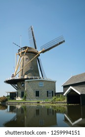 Windmill the Vriendschap along the river Graafstroom in the village  Bleskensgraaf Holland