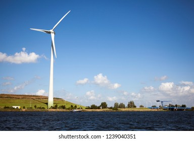 windmill from the water with blue sky