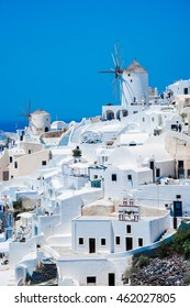 Windmill and white houses in Santorini Greece