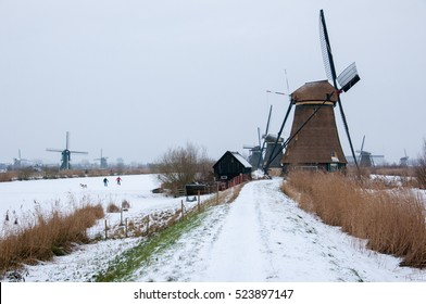 Windmill in a winter landscape snow and ice at Kinderdijk