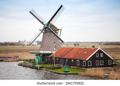 Windmill in Zaanse Schans historic town, Holland. It is one of the most popular tourist attractions of the Netherlands