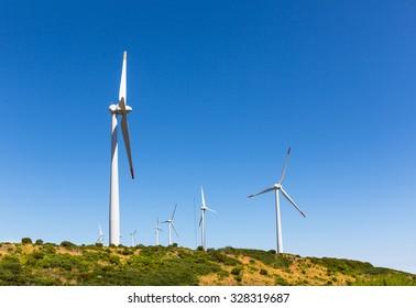 Windmills against clear blue sky