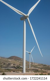 Windmills among the arid landscape of the south of Tenerife, in the Canary Islands, Spain