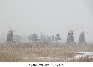 windmills and arbor in the snow, idyllic mood