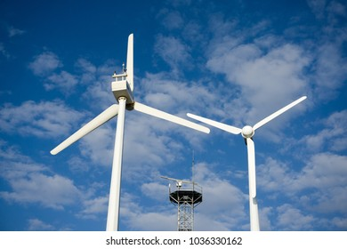 windmills with bright blue sky background