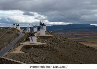 Windmills clouds and mountains
