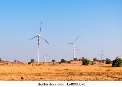 Windmills in the desert of Rajasthan near Jaisalmer. These are part of the clean energy projects in the region and provide sustainable renewable energy from desert winds