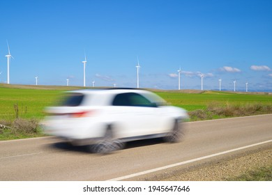 Windmills for electric power production and car, Zaragoza province, Aragon in Spain.