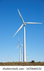 Windmills for electric power production, Huesca province, Aragon in Spain.