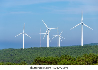 Windmills for electric power production on hill