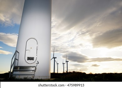 Windmills for electric power production at sunset, Zaragoza Province, Aragon, Spain.