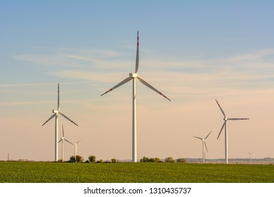 Windmills for electric power production surrounded by agricultural fields in Polish country side. Pomerania, Poland.