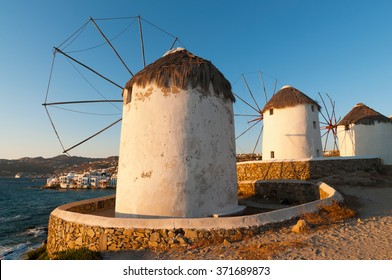 Windmills are famous landmark of Mykonos island, Greece , and in the backgroung little venice