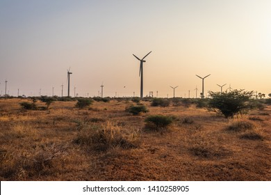 Windmills with farming fields indicating the new source of energy. Wind energy is the real example of developing rural life. Image is taken at dawn. image is taken at Coimbatore