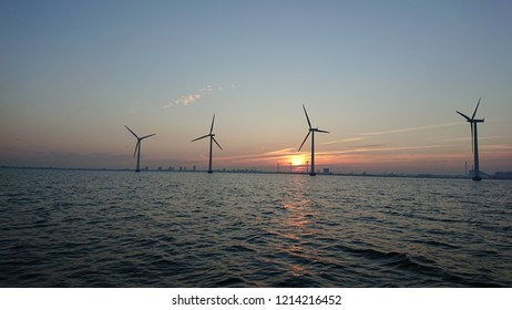 Windmills in front of the sunset at amager