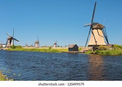 Windmills at Kinderdijk in a summer day.