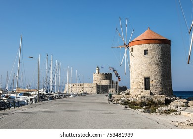 windmills in the Mandhraki Harbor, the yacht and ferry harbour in the city of Rhodes in Greece