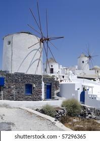 Windmills in Oia village on Santorini island