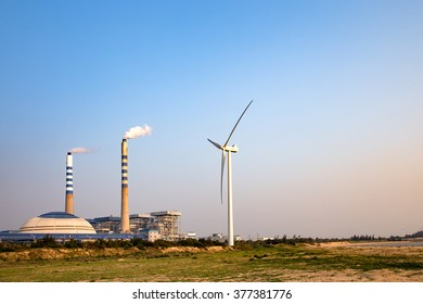 Windmills on the plants, blue sky background