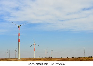 Windmills on the way to Sam Sand Dunes (Thar Desert) from Jaisalmer, Rajasthan, India. The Jaisalmer Wind Park is India's 2nd largest operational onshore wind farm.