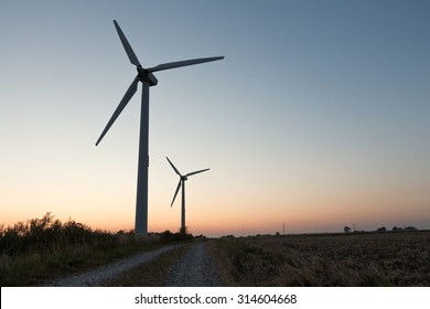 windmills and a pathway. can be used for windmills, energy, nature, climate and environment themes