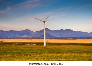 Windmills in the prairies at Sunrise, Alberta Canada