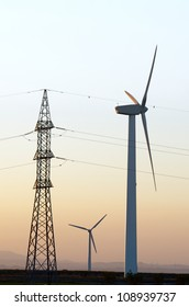 windmills for renewable electric energy production and high voltage tower, La Muela, Zaragoza, Aragon, Spain