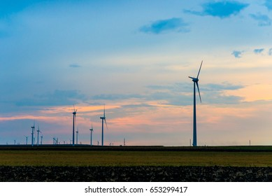 Windmills for renewable electric production from alternative energy source during sunset