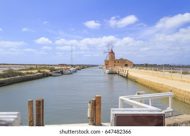 Windmills in the salt marshes of Marsala near Trapani Sicily