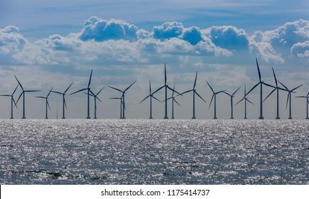Windmills in the sea. Wind power. Green energy - Shutterstock ID 1175414737