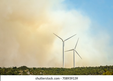 Windmills in a smoke cloud from a forest fire in Dalmatia, Croatia.