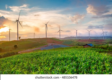 Windmills at sunset with cloudy sky in Khao Kho, Phetchabun, Thailand