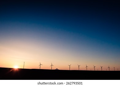 Windmills in sunset producing sustainable energy