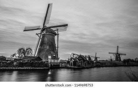 Windmills and water canal. Black-white photo.