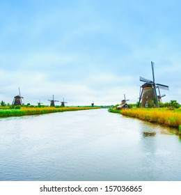 Windmills and water canal in Kinderdijk, Holland or Netherlands. Unesco world heritage site. Europe.