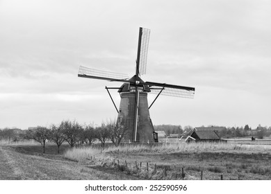Windmills and water canal in Kinderdijk, Holland or Netherlands. Unesco world heritage site. Europe. (black and white)