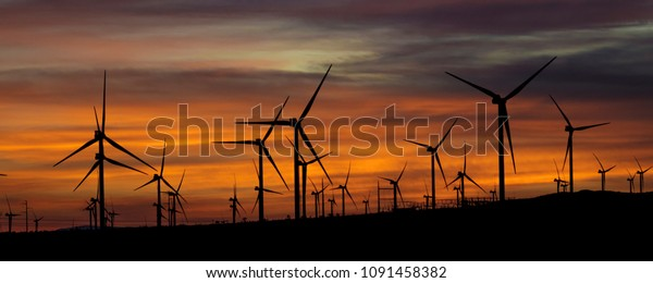 Windmills and windpower at sunset outside of Mojave, California
