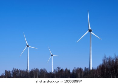 Windmills in the winter in the background of the forest