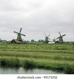 Windmills of Zaanse, North Holland, famous for its collection of well-preserved historic windmills and houses attracts 900,000 visitors every year