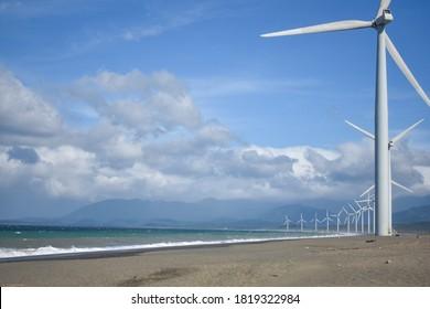 windmils blue sky beach oceanscape