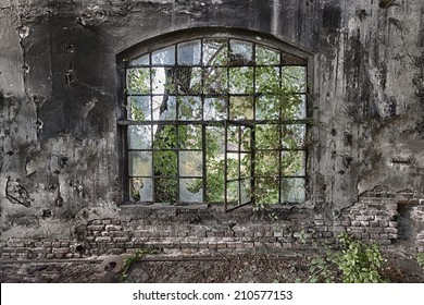 The  window in an abandoned, ruined factory