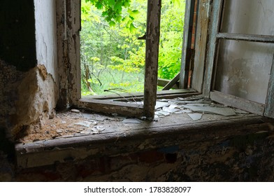 Window in abandoned school building in resettled village of Babchin in Chernobyl exclusion zone, Khoiniki district, Belarus