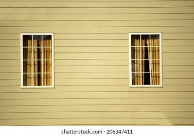 Window against vinyl siding at a local community