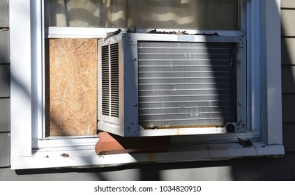 window air conditioner a/c at suburban house