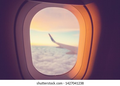 Window in the aircraft cabin. Travel background.