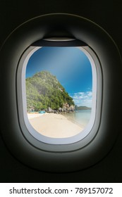 The window of airplane with travel destination attraction.