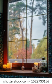 Window autumn view with candles