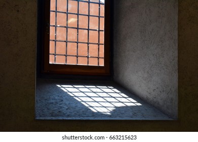 Window with bars leaving a shadow